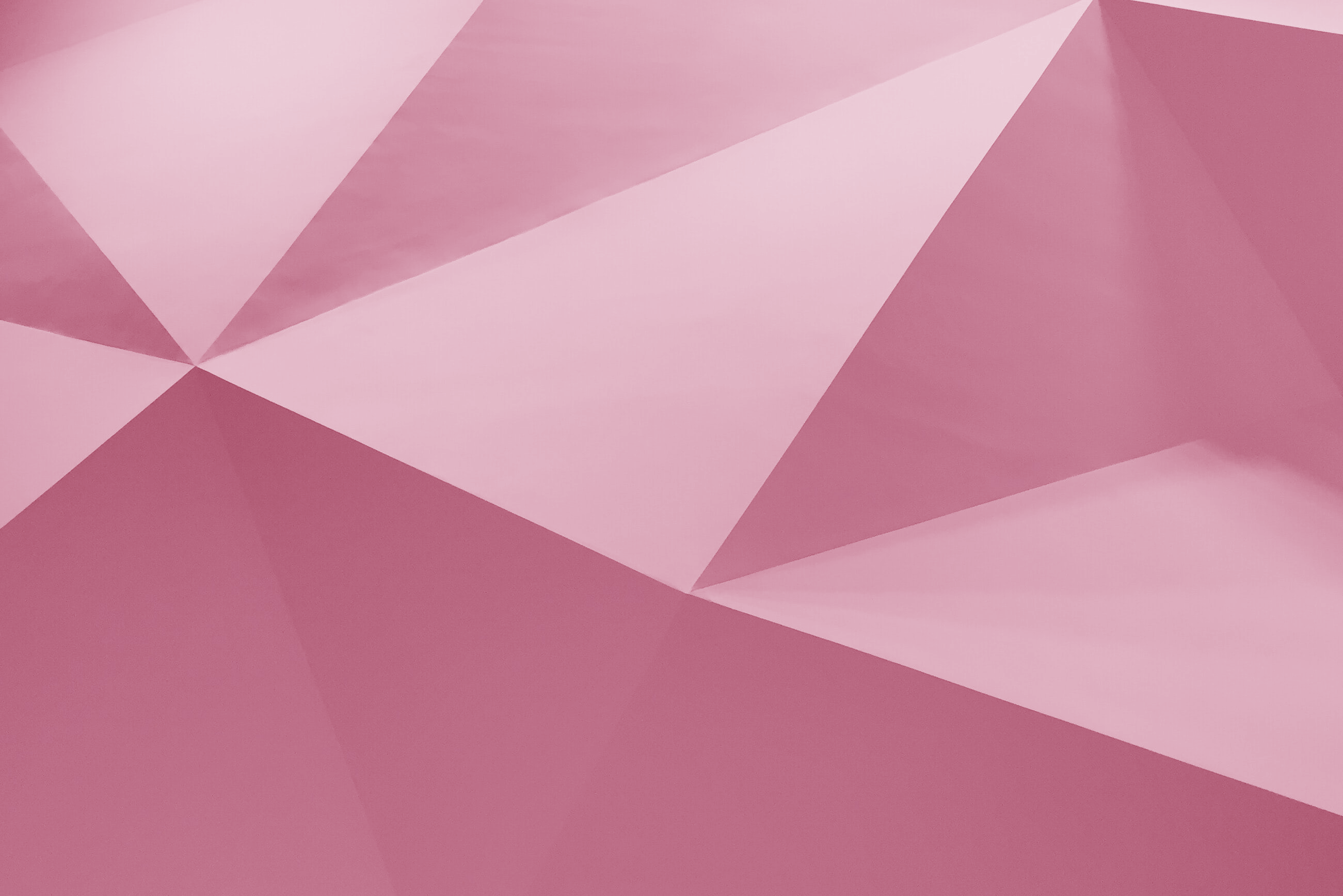 Pink coloured folded paper graphic